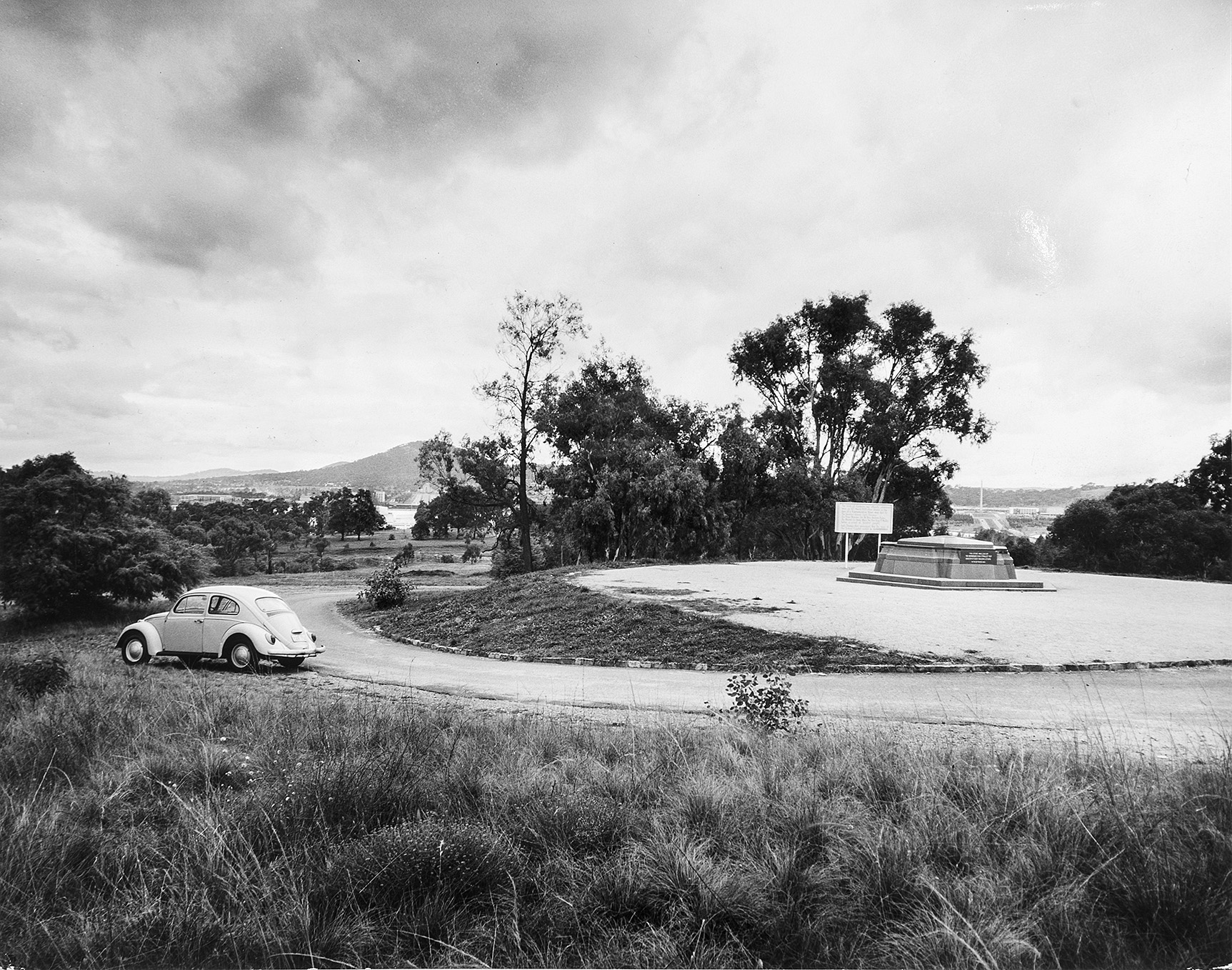 The base of the commencement column for the new capital. Looking from Capital Hill over Camp Hill towards the War Memorial, 30 May 1969